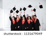 happy students in bachelor... | Shutterstock . vector #1131679049