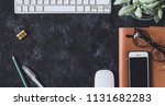 flat lay. working place on dark ...   Shutterstock . vector #1131682283
