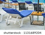 sun beds near a swimming pool | Shutterstock . vector #1131689204