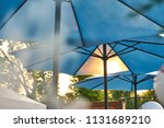 a beach umbrella blocks out the ... | Shutterstock . vector #1131689210