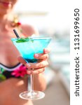 exotic cocktail glass in womans ... | Shutterstock . vector #1131699650