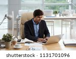 indian entrepreneur working on... | Shutterstock . vector #1131701096