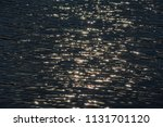 sun glare on the water | Shutterstock . vector #1131701120
