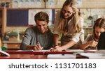 portrait of teacher looking at... | Shutterstock . vector #1131701183