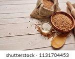millet wooden spoon            ... | Shutterstock . vector #1131704453