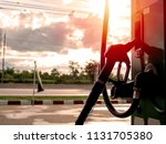silhouette close up petrol pump ... | Shutterstock . vector #1131705380