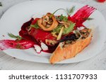 salad with squids in beetroot... | Shutterstock . vector #1131707933