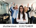 successful team of young... | Shutterstock . vector #1131714839