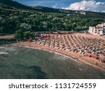 aerial view of a small sunny... | Shutterstock . vector #1131724559
