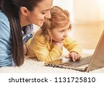 young mother and smiling... | Shutterstock . vector #1131725810