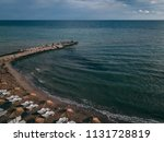 arial view of a small beach... | Shutterstock . vector #1131728819
