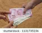 hand giving indian 500 and 2000 ... | Shutterstock . vector #1131735236