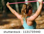 woman exercising with elastic... | Shutterstock . vector #1131735440
