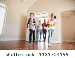 family opening door and walking ... | Shutterstock . vector #1131754199