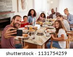 two families taking selfie as... | Shutterstock . vector #1131754259