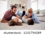 parents tickling children as... | Shutterstock . vector #1131754289
