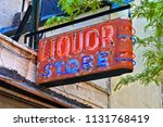 Small photo of Vintage consummate Liquor store neon sign on building in down town Manhattan, New York USA
