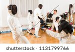 man and boy at fencing workout ... | Shutterstock . vector #1131799766
