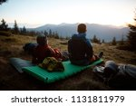 two hikers sit on the sleeping... | Shutterstock . vector #1131811979