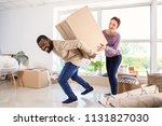 interracial couple carrying big ... | Shutterstock . vector #1131827030