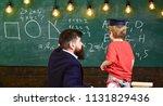 teacher and child turned back... | Shutterstock . vector #1131829436
