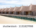 overwater bungalows in maldives   Shutterstock . vector #1131829988