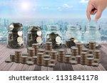 male hand putting money coins...   Shutterstock . vector #1131841178