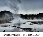 a geyser ejects hot water and... | Shutterstock . vector #1131852650