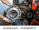 Small photo of View on old clean car truck clutch component part detail. Car clutch disc disk parts details components for maintenance repair Car clutch disc spare parts. Truck clutch disc Car parts component detail