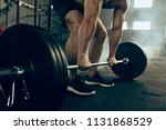 fit young man lifting weight... | Shutterstock . vector #1131868529