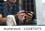man using phone at cafe. | Shutterstock . vector #1131872273