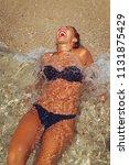 beautiful young woman enjoying... | Shutterstock . vector #1131875429