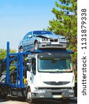 truck carrying a car that has... | Shutterstock . vector #1131879338