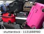 a lot of colorful suitcases ... | Shutterstock . vector #1131888980