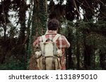 back view of young man who... | Shutterstock . vector #1131895010