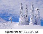Snowy landscape on Jahorina mountain near Sarajevo, Bosnia and Herzegovina, with blue sky and white clouds - stock photo