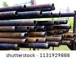 oil drill pipe. rusty drill... | Shutterstock . vector #1131929888