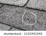 Small photo of Hail damage on roof after hailstorm