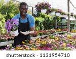 african american florist... | Shutterstock . vector #1131954710