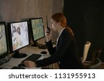 female security guard using... | Shutterstock . vector #1131955913