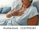 woman having a pain in the... | Shutterstock . vector #1131956183