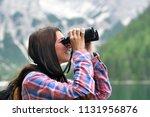 a beautiful woman camping ... | Shutterstock . vector #1131956876