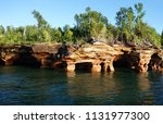the sea caves of devils island... | Shutterstock . vector #1131977300
