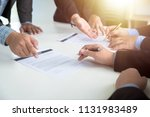 business team partners reading... | Shutterstock . vector #1131983489