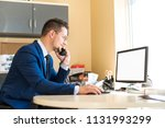 business man working at a car... | Shutterstock . vector #1131993299