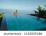 slim young woman in swimsuit... | Shutterstock . vector #1132025186
