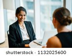 a young indian asian woman has... | Shutterstock . vector #1132025600