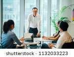 a chinese asian manager is... | Shutterstock . vector #1132033223
