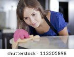 Cute Housewife Cleaning The...