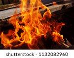 fire brazier on nature bones... | Shutterstock . vector #1132082960